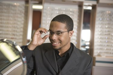 Man trying on glasses