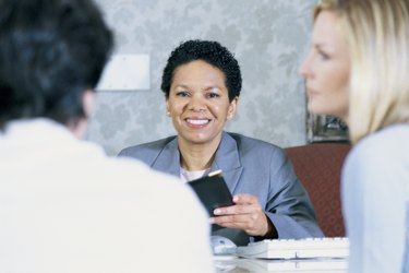 Loan officer with customers