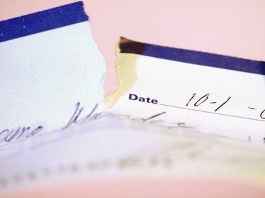 High angle view of a torn check