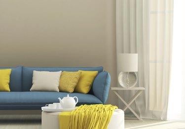 Light interior with blue sofa
