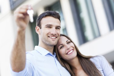 Couple with new house keys