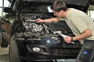 Car damage examining.