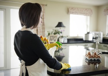 Woman cleaning the work surface
