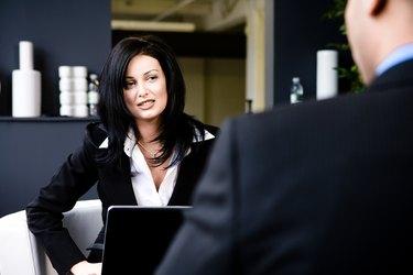 Businesswoman interviewing man