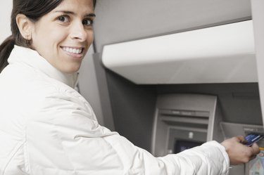 Young woman using an ATM