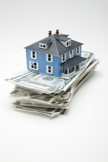 House on stack of money