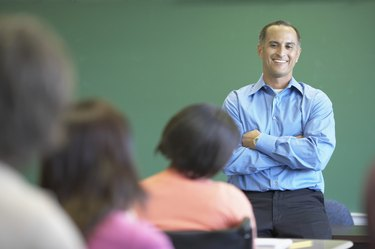Male lecturer standing in front of a classroom