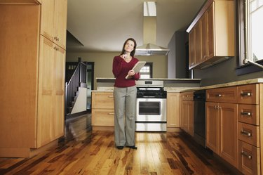 Woman inspecting empty kitchen