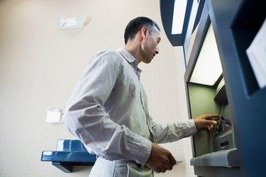 Man using cash machine