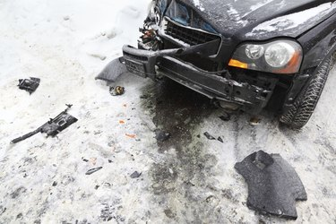 Broken car on road in winter; crash accident