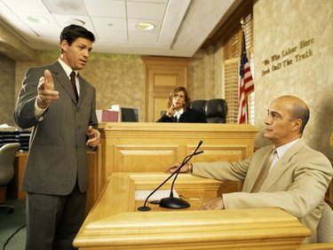 Side profile of a lawyer and a witness on the witness stand