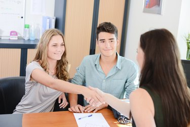 woman shaking hands with banker