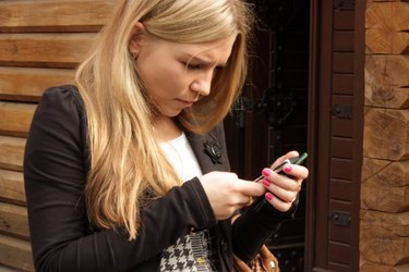 Blonde woman looking at cell phone