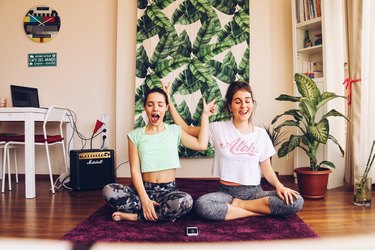 Two women doing silly yoga together