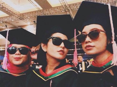 three women graduating