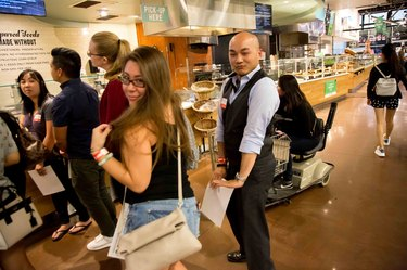 Two customers dancing in line at Whole Foods