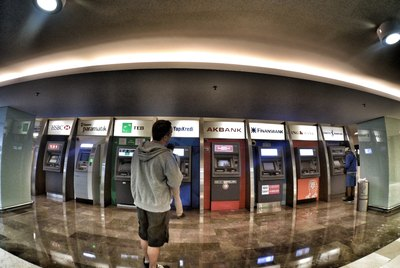 Man standing in front of multiple ATMs
