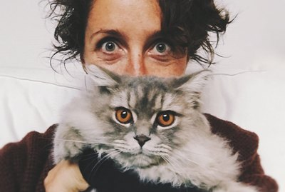Woman's selfie with gray fluffy cat