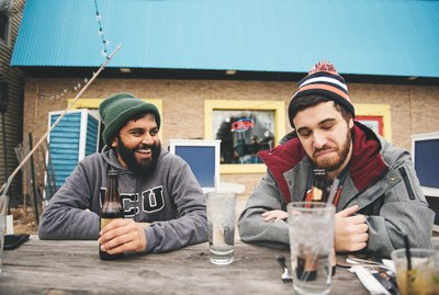 Two guys enjoying a beer