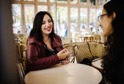 Woman in red lipstick and red leather jacket in conversation