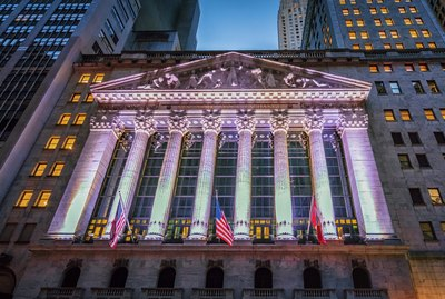 U.S. Stock Exchange lit up pink at dusk