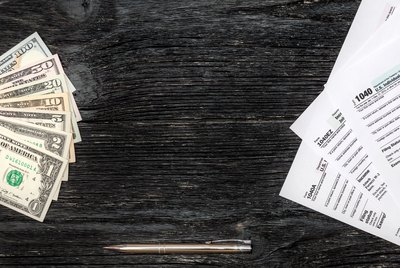 Frame from money and tax form on the wooden background
