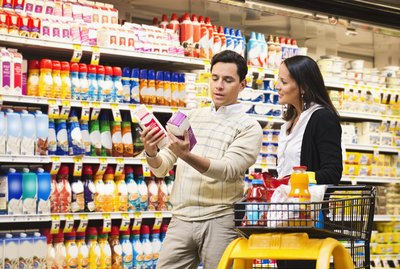 Hispanic couple shopping in grocery store