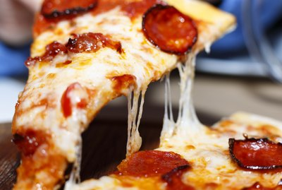 Closeup of a piece of pepperoni pizza. Italian pizza.