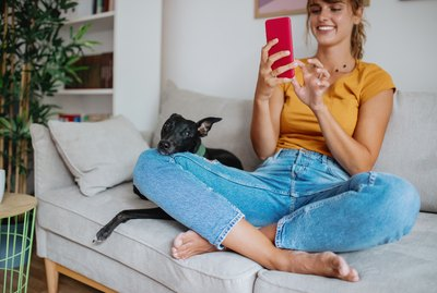 Photo of a young woman using a smart phone