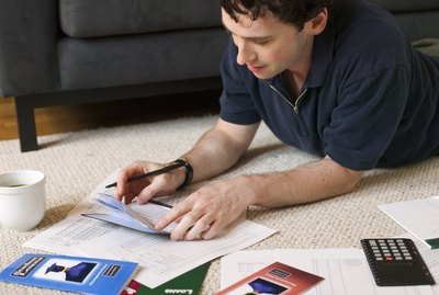 What Does Administration Forbearance Mean?Man paying bills