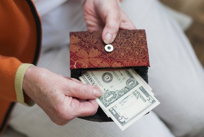 Can a Wife Collect Off Her Husband's Social Security If He Is Still Alive?Senior women looks in her purse