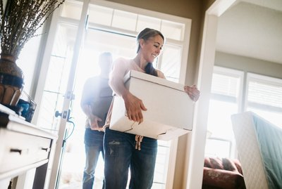 Mature Couple with Moving Boxes in New Home