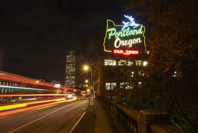 Highway and neon sign at night, Portland, Oregon, USA
