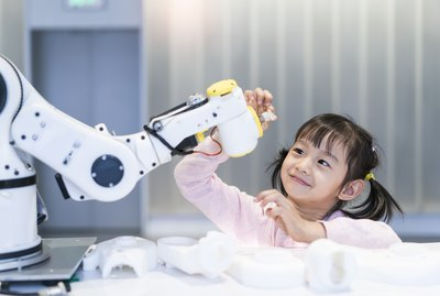 little Girl Building Robotic Arm At School