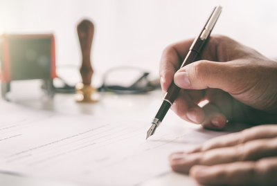 Notary signs legal contract. Businessman working in office
