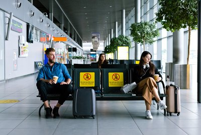 Passengers waiting for flight in airport terminal