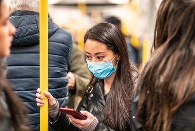 Chinese woman wearing face mask in the train