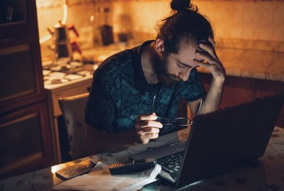 Frustrated man having troubles to pay the bills