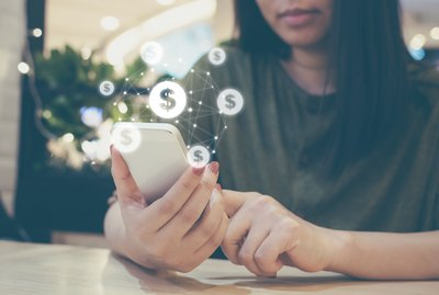 woman hand using mobile phone with online transaction application, Concept ecommerce and internet online investment