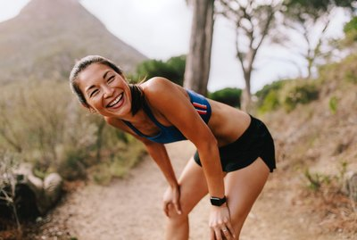 Female runner taking a break after workout
