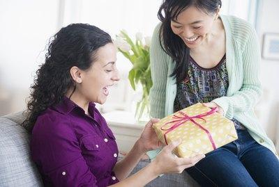 Woman giving friend birthday present