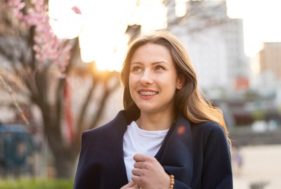 Portrait Shot of Beautiful Polish Woman with Braces During Sunset