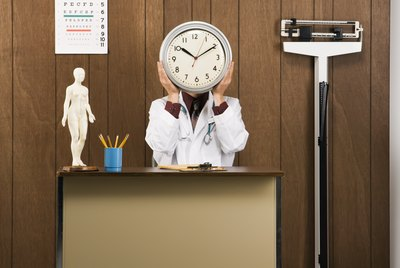 Doctor holding clock.