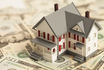 What Is an Escrow Number?                   Single family house on pile of money
