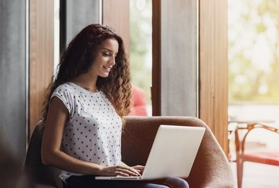 Happy girl using laptop computer