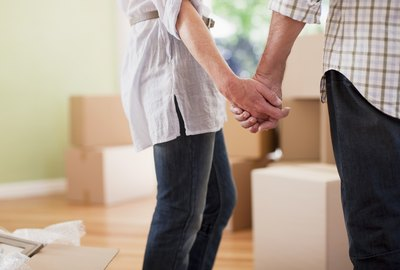 Couple holding hands in new house
