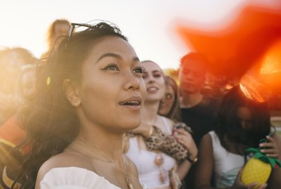 Smiling woman in crowd enjoying at music festival