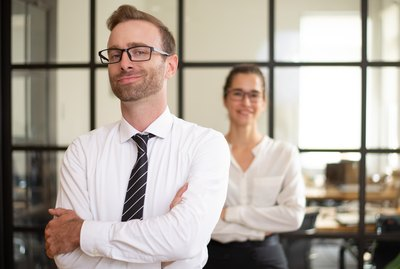 Confident middle-aged business man posing in office