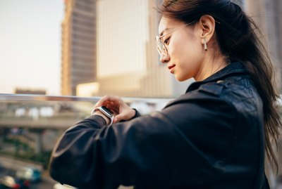 Asian businesswoman with smart watch.