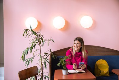 Happy Millennial in Colorful Cafe in Belgrade, Serbia